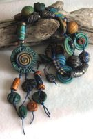 Green Spiral Pendant Necklace by desertwind56