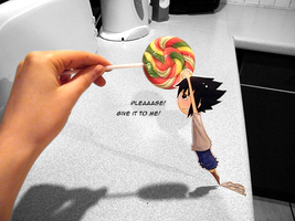Sasuke want a lollipop by MlleLowra