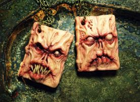 Necronomicon book of the dead polymer clay pendant by dogzillalives