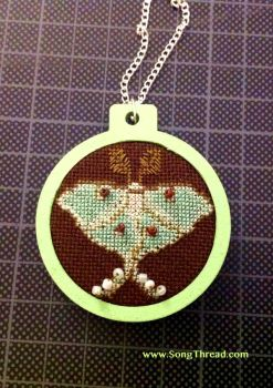 Luna moth pendant by SongThread