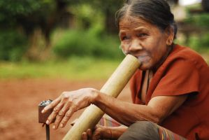 Laos - old lady with bong by sevenths