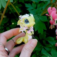 Pale yellow baby dragon with cherry blossoms by BittyBiteyOnes