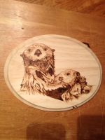 Pyro Sea Otters by H20dog