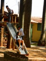 children playing on the slide by Paulo-Vitorelli