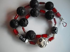 red, black, white necklace by merpagigglesnort