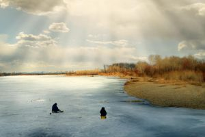 Fishermen on the ice in spring day by Korolevatumana