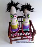 Handmade ooak monster dolls on bench by Snotnormal