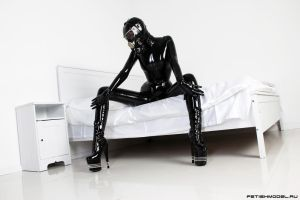 Black Latex Rubber Girl in a White Room. 18 by agnadeviphotographer