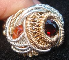 gold silver garnet ring by nonomie