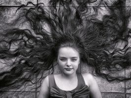Her hairs getting longer.. by Harpyimages