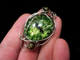 Simple wrapped eye in tones of green by BacktoEarthCreations