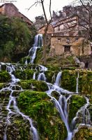 Waterfall crossing the village. by MarioGuti