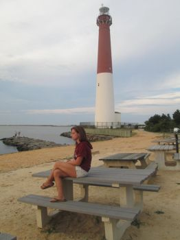 watching the boats at the Lighthouse by Singinchic7