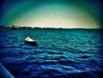 boat in the deep blue sea by maryapasol
