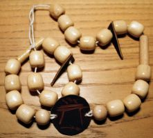 Wooden necklace? by Meow-chi