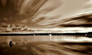 Jetting Clouds sepia version by liquidozzwald