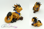 Zlato the golden griffin by CalicoGriffin