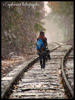 Girl walking down the tracks in the snow by EuphoricPhotographs