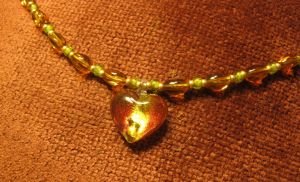 Green and Orange Heart Necklace Closeup by Windthin
