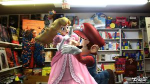 Mario and Peach in the bookshop by Zellphie