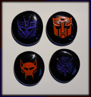 Black Glass Engraved Transformers Insignias by ChimeraDragonfang