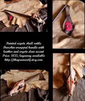 Brown coyote skull rattle by lupagreenwolf
