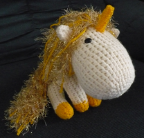 Lir the unicorn amigurumi by craftybird