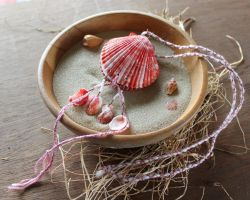 Red shell scallop necklace by lupagreenwolf