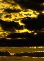 golden clouds by ogiedomane