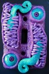 Purple and teal monster switchplate by dogzillalives
