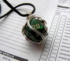 Wire Wrapped Green and Purple d20 by lavadragon