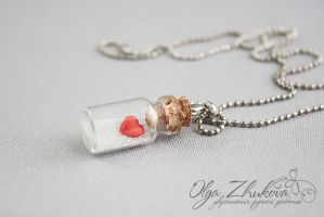 Glass bottle with a heart made of polymer clay by polyflowers