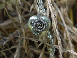 Steampunk rose locket by Hiddendemon-666