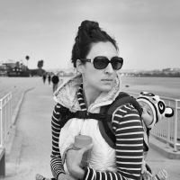 Woman with Baby Panda by clippercarrillo