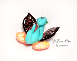 Blue and pink baby Butterfly dragon by rosepeonie