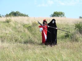 Cosplayers descending a hill by Tatheya