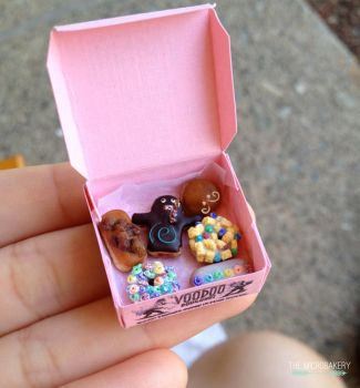 Box of Voodoo Doughnuts by TheMicroBakery