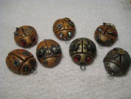 Polymer Clay Steampunk Beetle Charms by justasfastasican