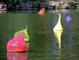 Chihuhli Glass Floats On Kew's Palm House Lake by aegiandyad