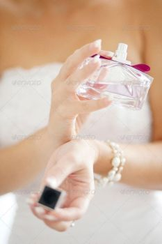 Bride Spraying Perfume On Her Wrist by Ondrejvasak
