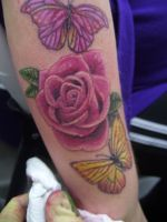 rose and butterfly tattoo by LianjMc