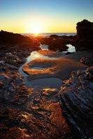 Sun Pools and Wet Rocks by twelvemotion