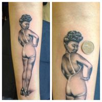 Sexy pin up girl tattoo by DaneTattoo