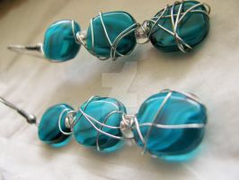 Teal dangling silver wire wrap earrings by SomethingTeal