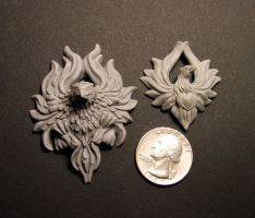 Phoenix pendants new and old by Meadowknight