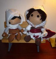 Altair and Ezio on a Bench by Kaxen6
