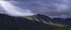 Light Ray Over Mountain Ridge by JaggedTech