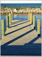 dock shadows by SAVALISTE