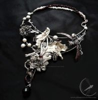 The inside story - silver surrealist necklace by RekamiStworzone