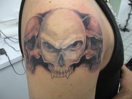 skulls tattoo by kamuyart
